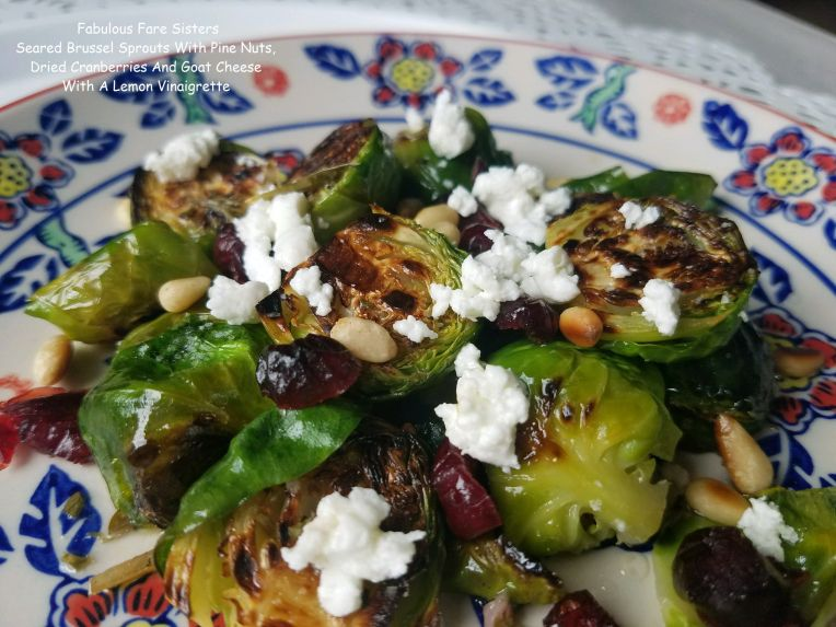 Seared Brussel Sprouts With Pine Nuts, Dried Cranberries And Goat Cheese With A Lemon Vinaigrette